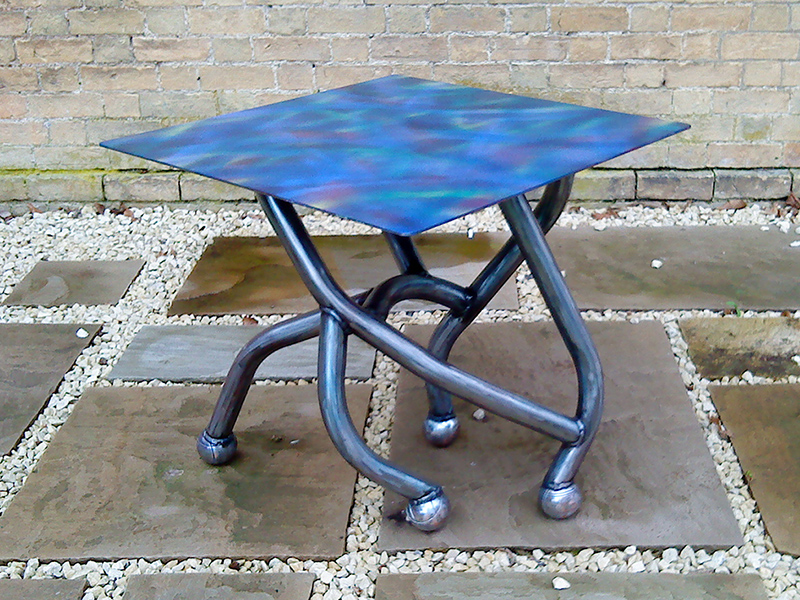 The Boule Chair - Contemporary metal table created from metal tubing and petanque balls with painted top
