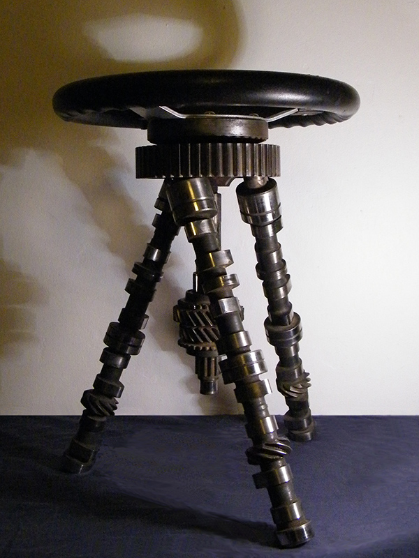 Modern welded metal furniture - created from car parts including mini camshafts and steering wheel