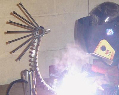 Ashley arc welding a new metal sculpture
